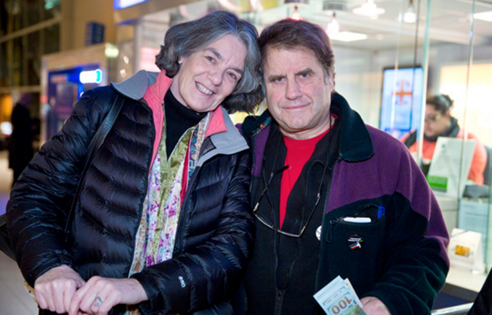 Maggy Willcox and her husband, Peter, pose after their arrival Friday night at Logan International Airport in Boston. Peter Wilcox had been imprisoned by Russia for two months after being arrested during a protest at a Russian oil rig in the Arctic in September.