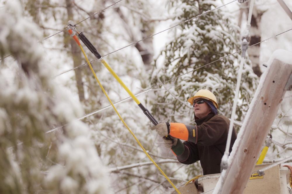 Maine Public Service lineman Craig Hobbs works to restore power in Orrington on Sunday.