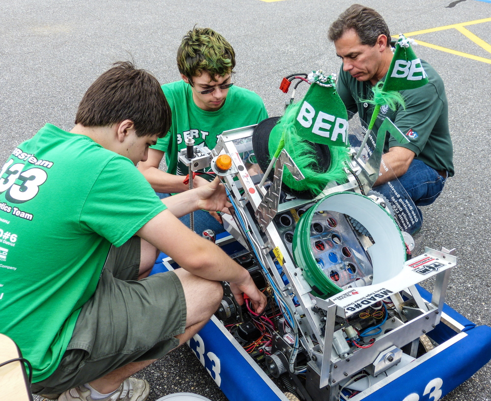 """The Bonny Eagle High School Robotics Team has won a $1,000 grant and placed second in an international engineering competition for its """"First Foot"""" engineering concept about a shoe that collects and stores energy."""