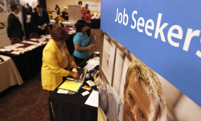 In this Tuesday, July 2012 file photo, people mingle with recruiters at a jobs fair. As many as 3,300 Mainers could lose a key source of income – if not their only source – during the holidays because Congress has not extended a long-term unemployment program.