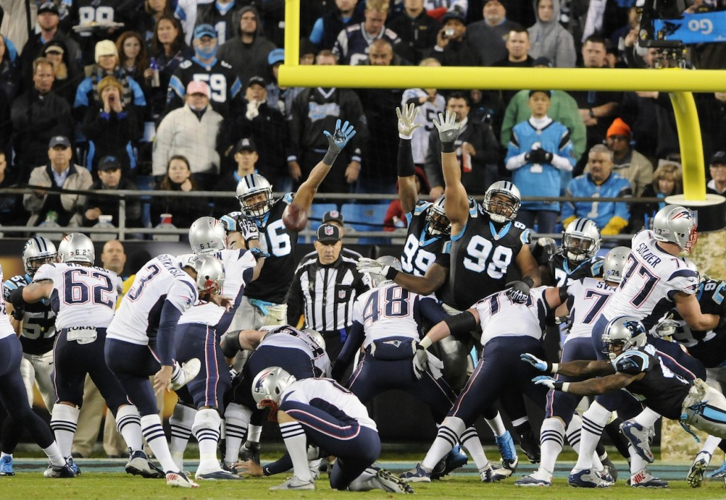 New England Patriots kicker Stephen Gostkowski (3) kicks against the Carolina Panthers during the second half of an NFL football game in Charlotte, N.C., Monday, Nov. 18, 2013. (AP Photo/Mike McCarn)