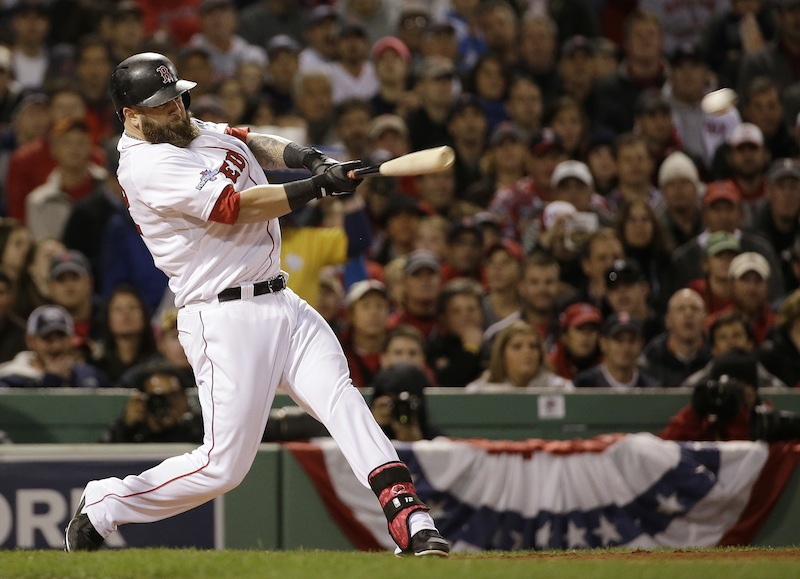 Mike Napoli hits a double that scored three runs in the first inning of Game 1 of the World Series against the St. Louis Cardinals. Napoli has re-signed with the Red Sox.