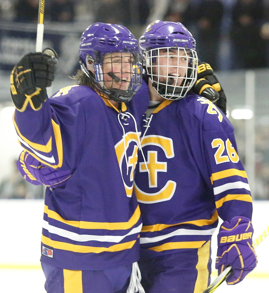 Conor Ryle, left, of Cheverus celebrates with teammate Alex Grant-Roy after scoring during the second period of the 8-0 victory against Portland/Deering in the City Cup on Wednesday.