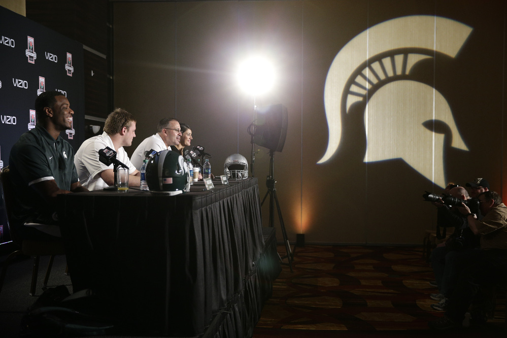 Michigan State defensive end Shilique Calhoun, from left, defensive end Marcus Rush and defensive coordinator Pat Narduzzi attend a news conference on Friday.