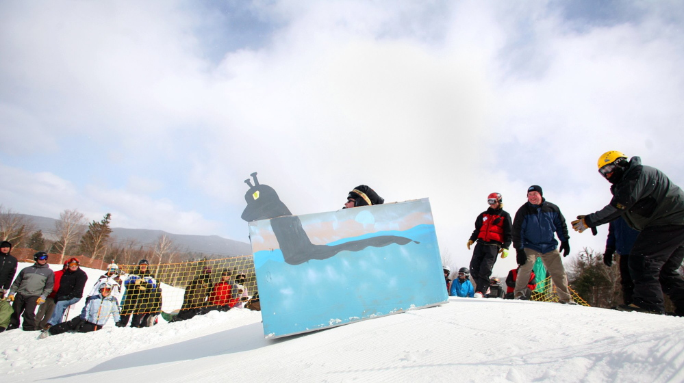 """A cardboard sled called """"The Mooselook Monster"""" heads down the slope during the Cardboard Box Race at Saddleback Mountain in Rangeley in 2011."""