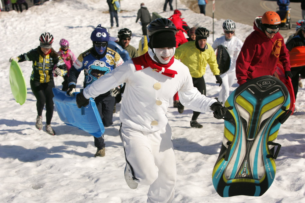Justin McClogan and other participants dash up the Portland's the hill of Portland's Eastern Promanade during the first leg of the 2011 Snowman Adventure Race.