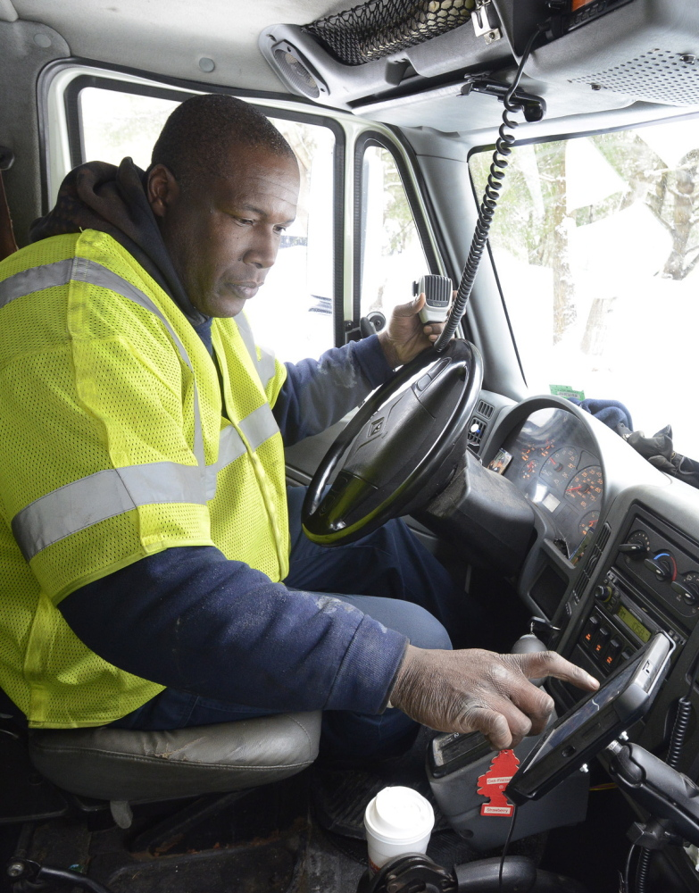 AAA tow truck driver Matt Ivey checks for his next call on his onboard tablet computer Thursday.