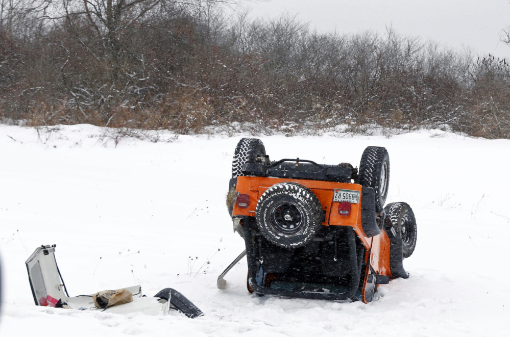 A vehicle sits upside down after spinning out of control on Interstate 295 in Portland during Thursday's snowstorm. Numerous accidents were reported on Maine roads throughout the day because of bad driving conditions, but none was serious.