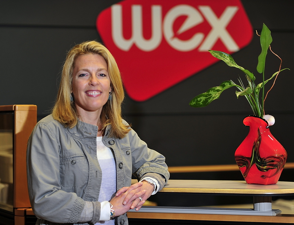 Melissa Smith, the new CEO of Wex, says the credit card processing company's headquarters will stay in Maine and will grow as the company does. She succeeds Michael Dubyak in leading the company originally called Wright Express.