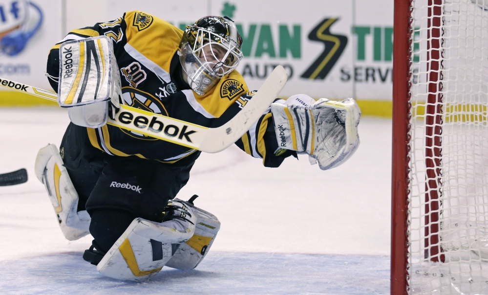 Boston Bruins goalie Niklas Svedberg dives back for a save against the Nashville Predators during the first period Thursday in Boston.