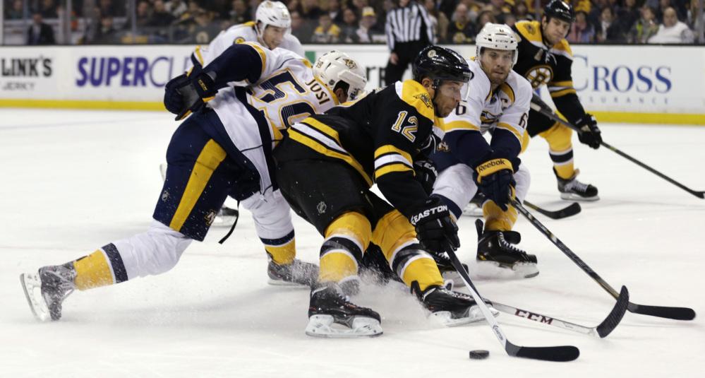 Boston Bruins right wing Jarome Iginla (12) skates past Nashville Predators defenseman Roman Josi, left, as defenseman Shea Weber (6) tries to poke the puck away during the second period Thursday in Boston.