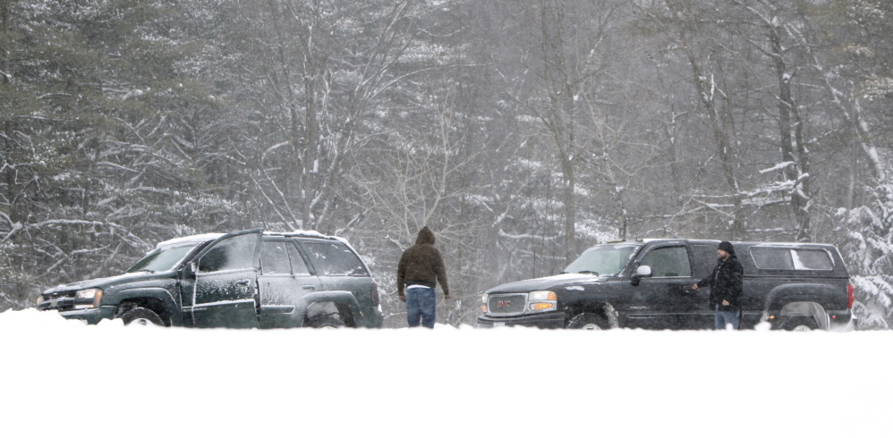 A driver of a truck stops to help someone whose car got stuck in a snowbank in the southbound lane of the Maine Turnpike in Arundel on Friday. Experts debunk some of the myths about operating motor vehicles and staying warm in cold and snowy weather.