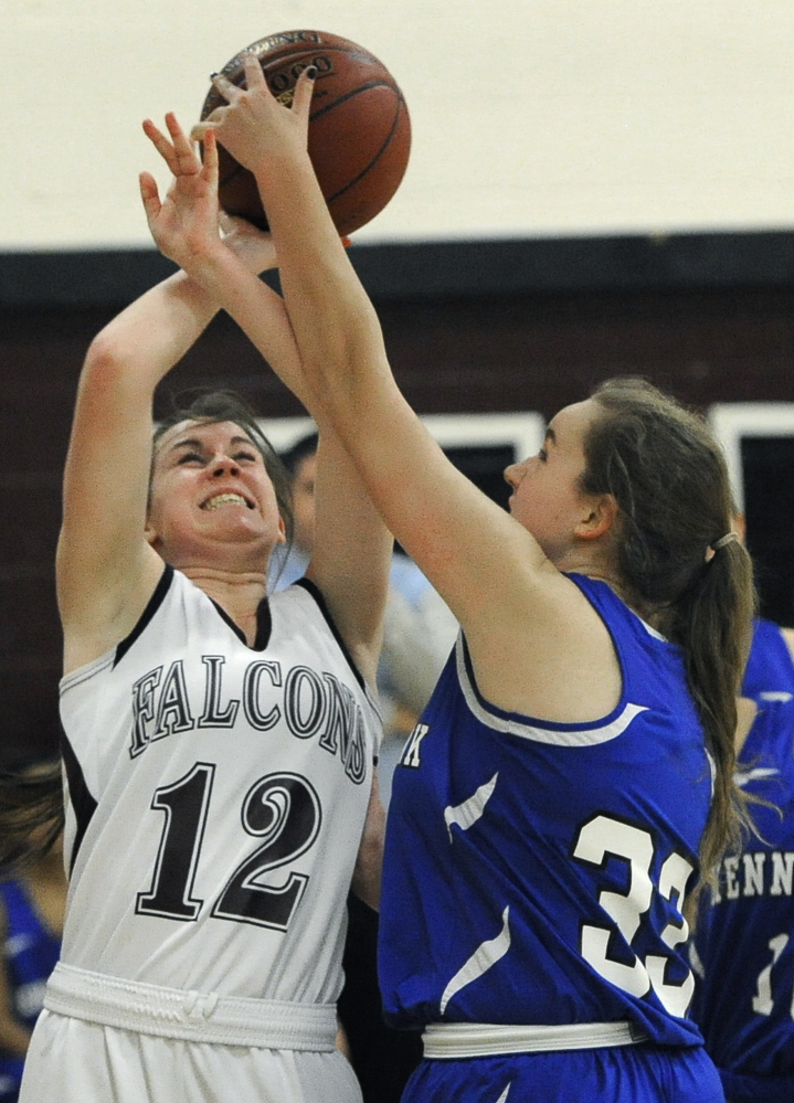 Livy Dimick of Freeport, left, is fouled by Abigail Doyle of Kennebunk while attempting to get off a shot. Freeport improved to 2-5 and dropped Kennebunk to 2-5.