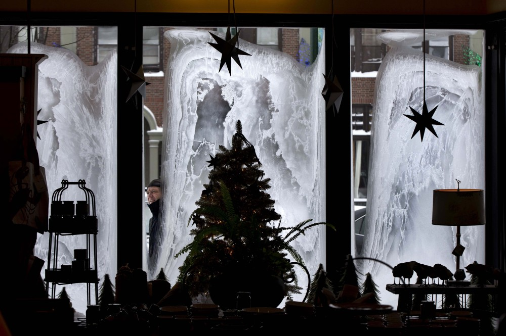 """With the temperature hovering around zero degrees, John Faulkner checks on the frosty windows of his eclectic home furnishing store, Nest, on Friday in Brunswick. """"We haven't seen frost like this before,"""" said Faulkner. """"It's like living in a refrigerator."""""""