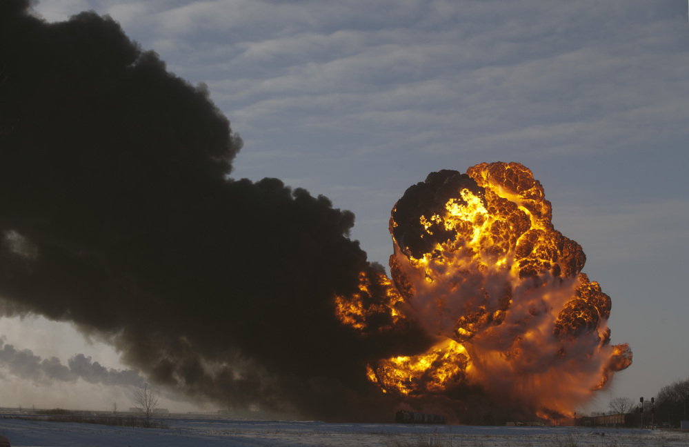 A fireball blooms as an oil train derails Monday in Casselton, N.D. The North Dakota accident is the fourth major derailment in North America in six months involving trains transporting a type of crude oil that safety officials said is more flammable and dangerous to ship by rail. Among other things, regulators called for better labeling and stronger tank cars.