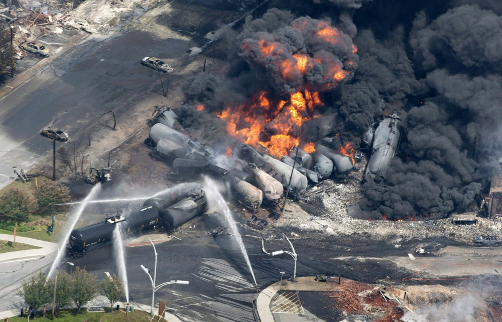 A photo from July 6 shows smoke and flames rising from the debris of a 72-car runaway train that derailed as it transported crude oil at Lac-Megantic, Quebec. Several of the train's cars exploded, 40 buildings in the town were leveled and 47 people were killed in the disaster.