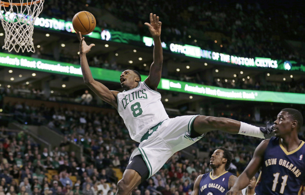 Boston Celtics forward Jeff Green may not win style points as he drives to the basket against the New Orleans Pelicans during third-quarter action of Friday's game in Boston. Green had 16 points and 11 rebounds, but it wasn't enough as the Pelicans held on to win.