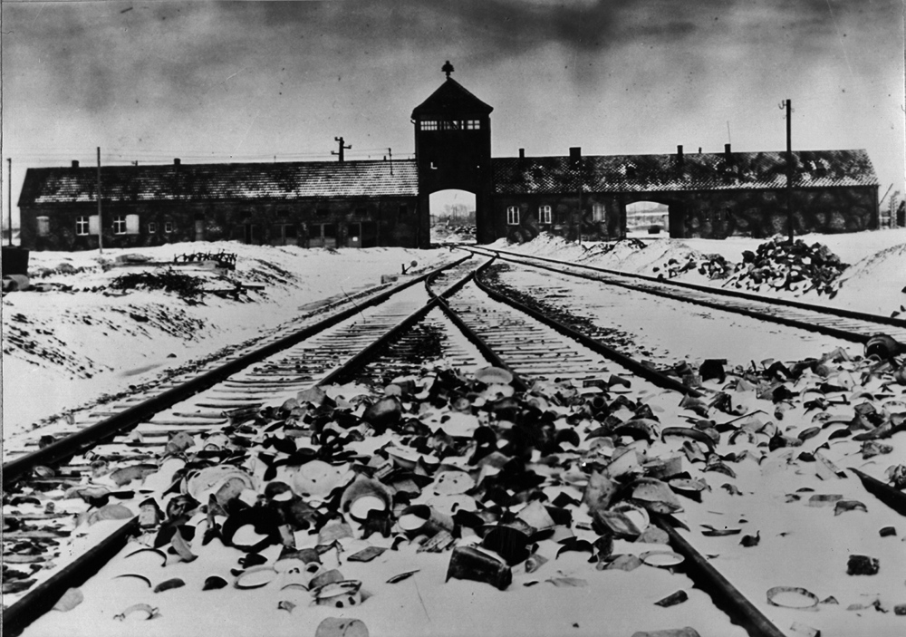 The entry to Auschwitz-Birkenau in Poland, with snow-covered rail tracks leading to the camp in the winter of 1945. Auschwitz-Birkenau was the largest German-held concentration camp and the place where Etty Hillesum and members of her family died in 1943 at the hands of Nazi forces at the height of World War II.