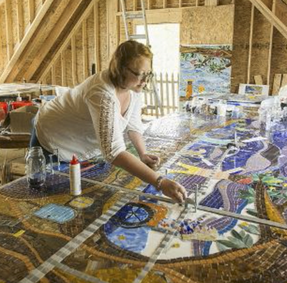 "Amanda Edwards of Cape Elizabeth works on a glass mosaic. ""My work has no big hidden meanings,"" she says. ""It's just simply color, joy, love and moments of imaginative freedom."""