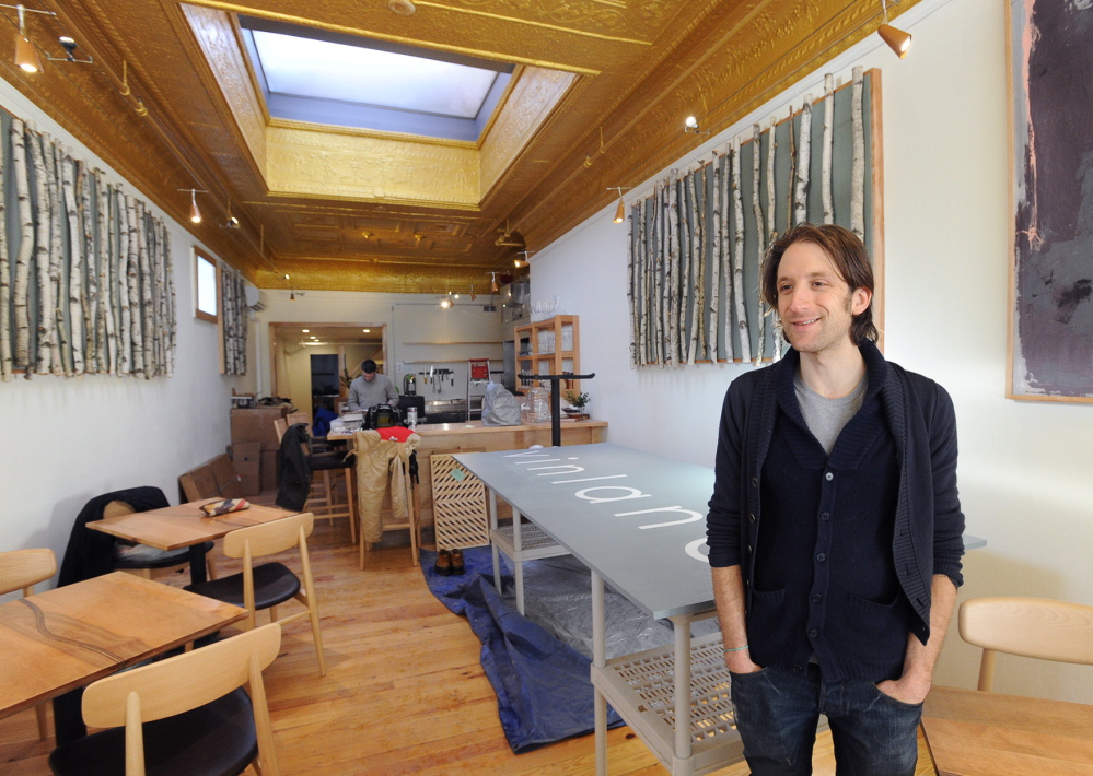 Chef/owner David Levi, shown last month during preparations for the opening of his restaurant Vinland, is a former high school teacher with a master's degree in poetry. He got his culinary training in several countries.