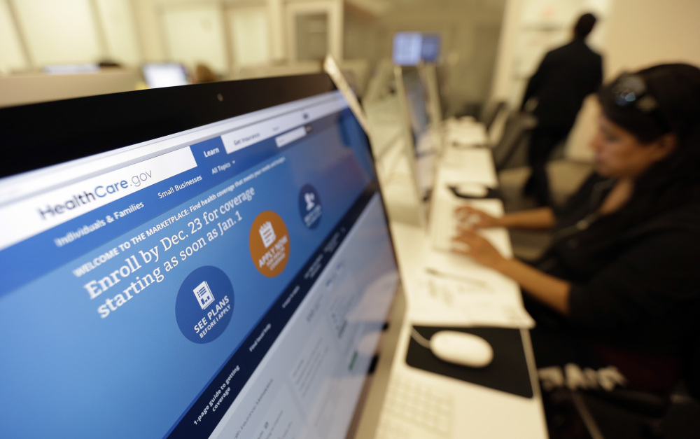 A woman uses a computer at a public library in San Antonio, Texas, on Dec. 13 to access the Affordable Care Act website. Even if health care reform in the United States is far from complete, the news so far should be encouraging.