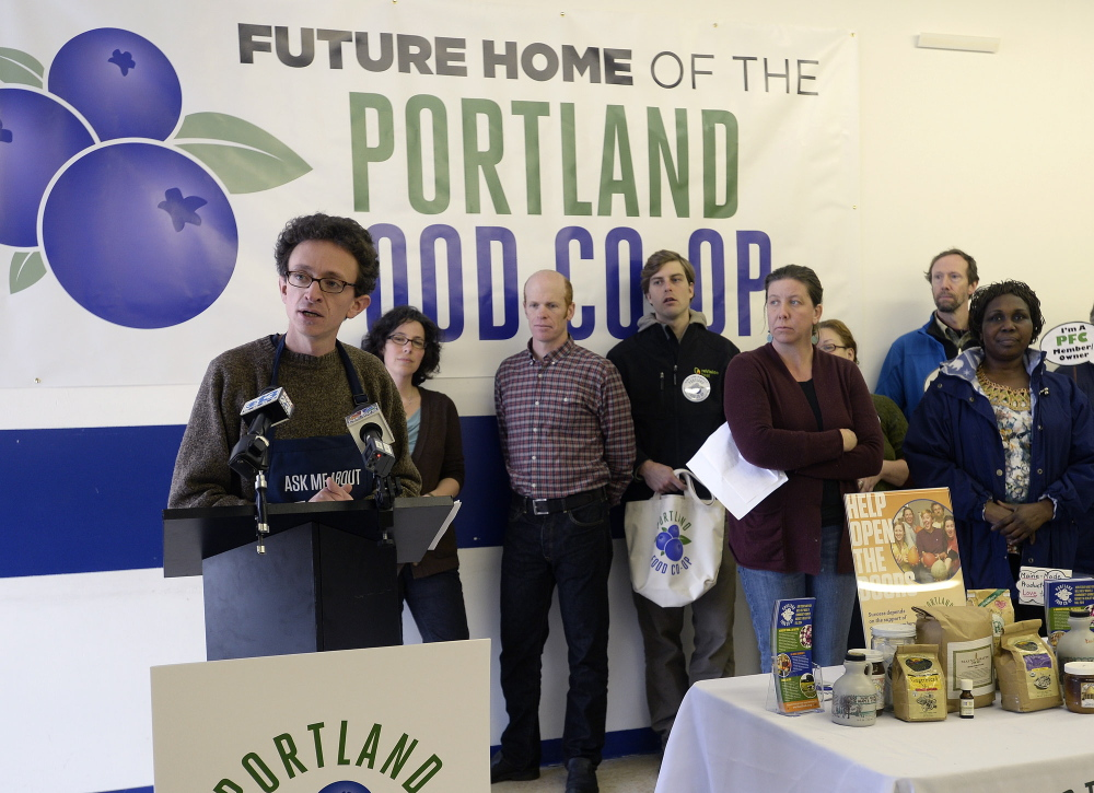Portland Food Co-op President Daniel Ungier speaks during a news conference at the new storefront location for a full-service grocery store at 290 Congress St. in Portland on Monday.