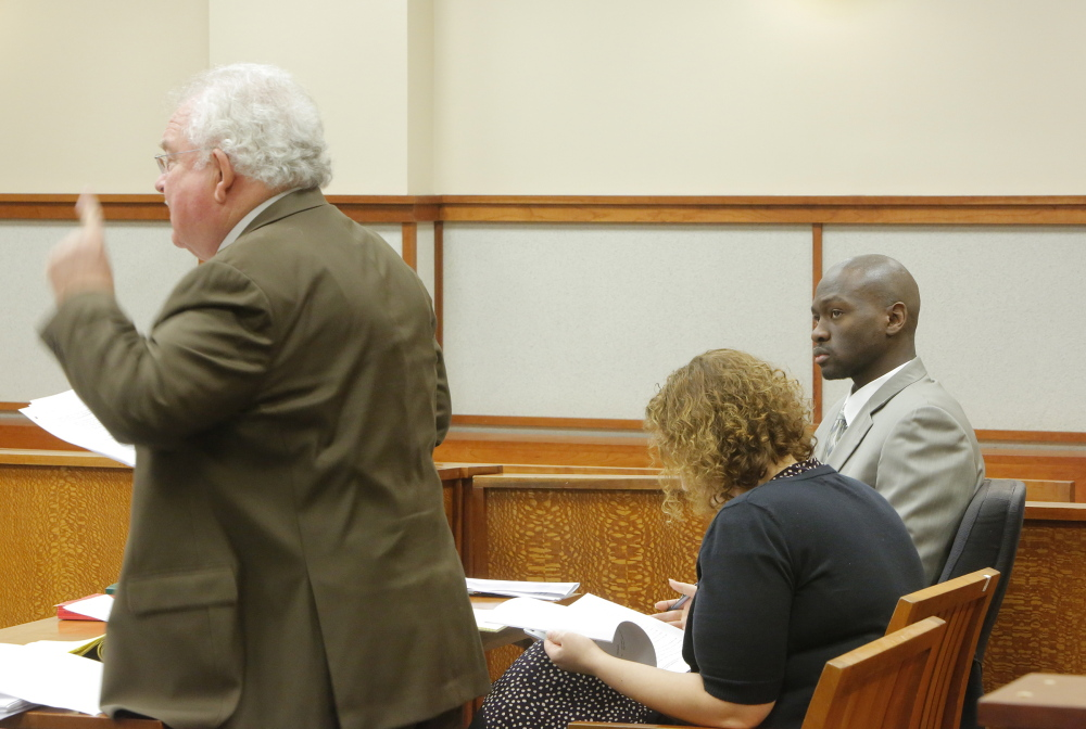 Eric Gwaro looks to his attorney Daniel Lilley as Lilley addresses Justice Joyce Wheeler during Gwaro's sentencing at Cumberland County Unified Criminal Court in Portland on Monday, Janaury 6, 2014. Gwaro was sentenced to eight years in prison for his attack on Sherri York in 2012.