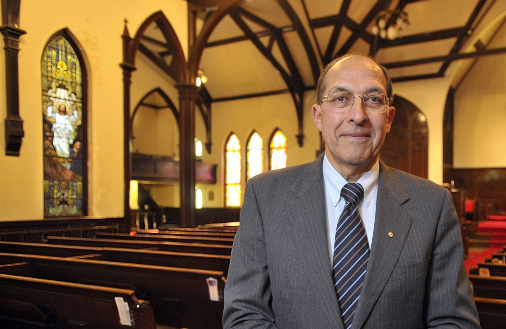 Frank Monsour, owner of the Williston-West church building, stands in the sanctuary. Monsour has wanted to use the Parish House as the U.S. headquarters for his technology development startup, Majella Global Technologies.