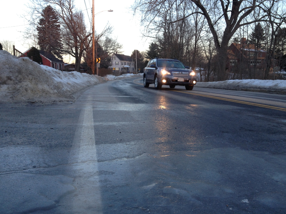 Large patches of ice make travel on Capisic Street dangerous for early morning travelers.