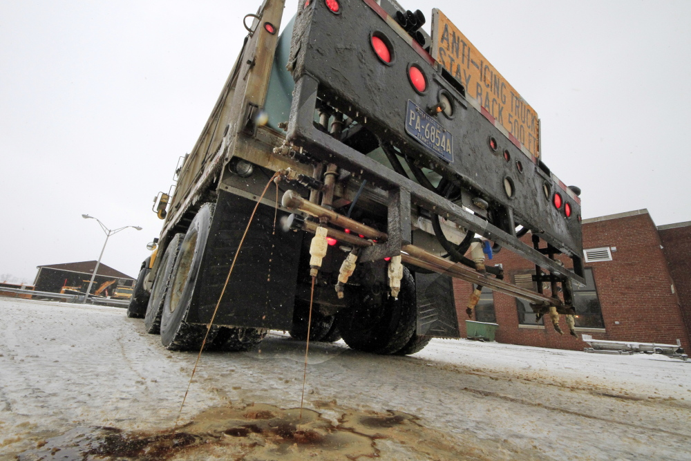 A Pennsylvania Department of Transportation de-icing truck sprays a cocktail of brine and beet juice on the driveway of PennDot's Butler, Pa., maintenance facility.