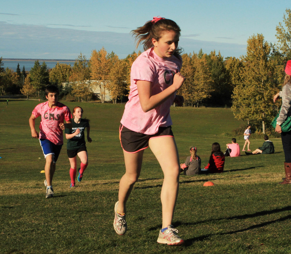 Middle school students in Anchorage, Alaska, climb a hill during a cross-country race Tuesday. The Centers for Disease Control and Prevention says only 1 in 4 U.S. kids aged 12 to 15 meet the recommendations of an hour of moderate to vigorous activity every day.