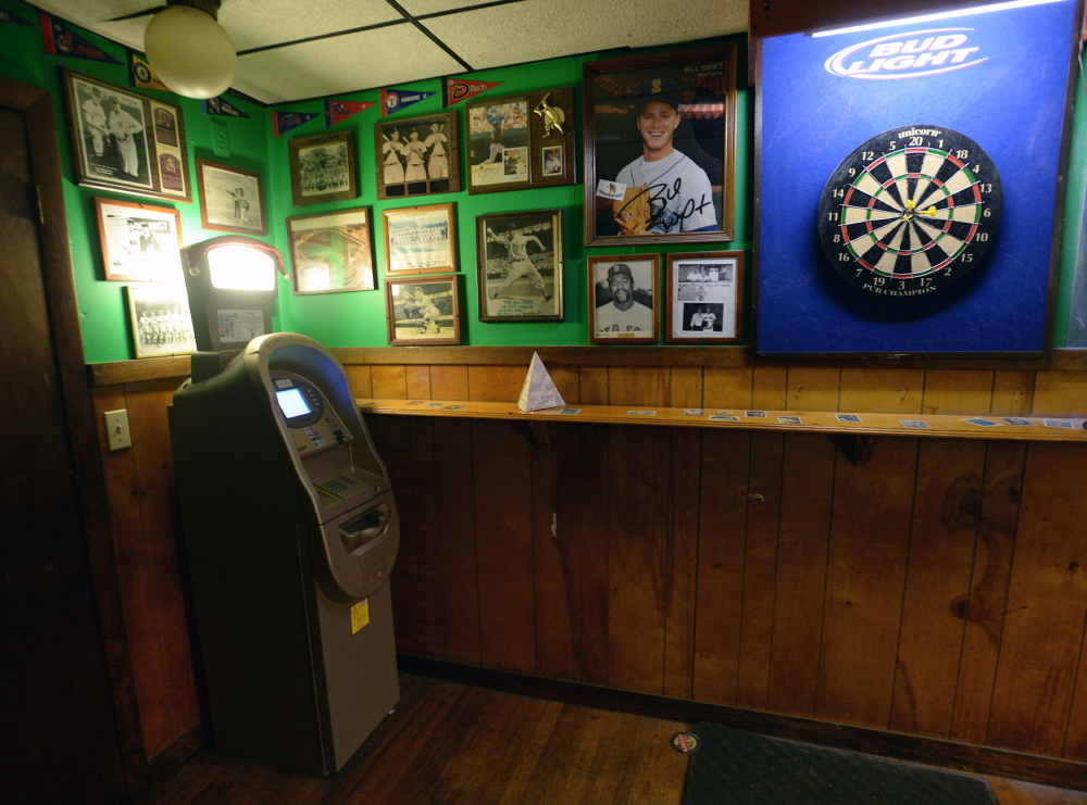 An ATM, left, is available for customer use Tuesday at the Griffin Club in South Portland. The EBT data released by the state Tuesday did not specify whether transactions were purchases or ATM withdrawals.