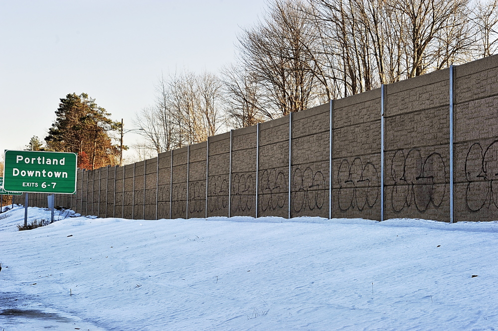 Officials say they won't know how much it will cost to paint over the graffiti on an Interstate 295 barrier wall in South Portland until the work begins once the weather warms up.