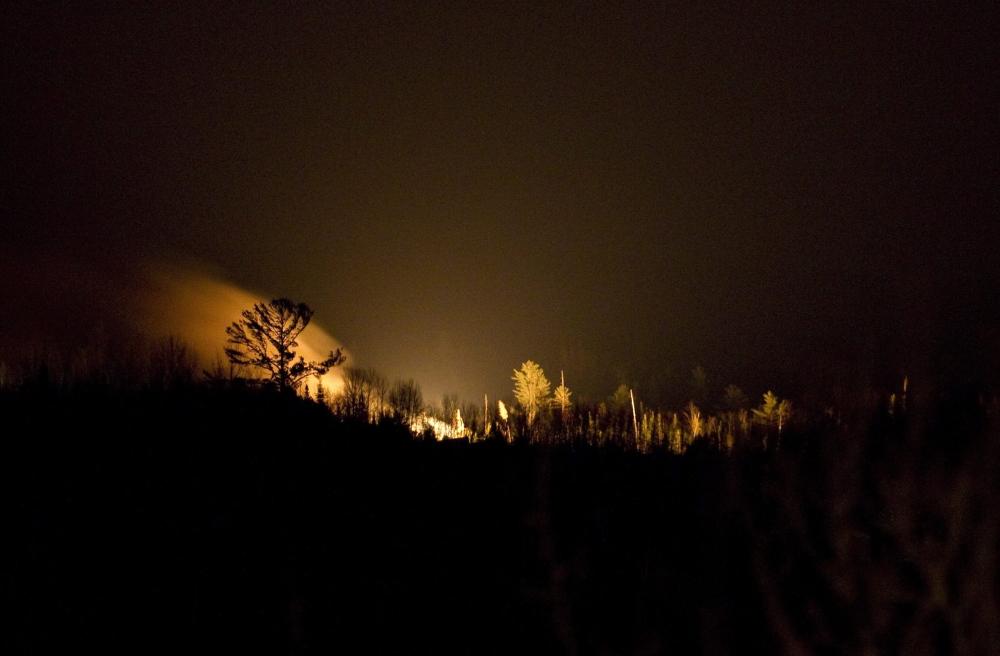 Fire burns on the horizon at the scene of a train derailment near Plaster Rock, New Brunswick, on Wednesday.