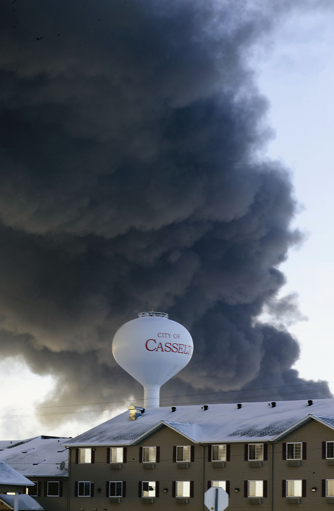 A fireball goes up at the site of an oil train derailment in Casselton, N.D., last month. Its cargo was a highly flammable crude oil from western North Dakota. Senators are pushing for action after a string of derailments.
