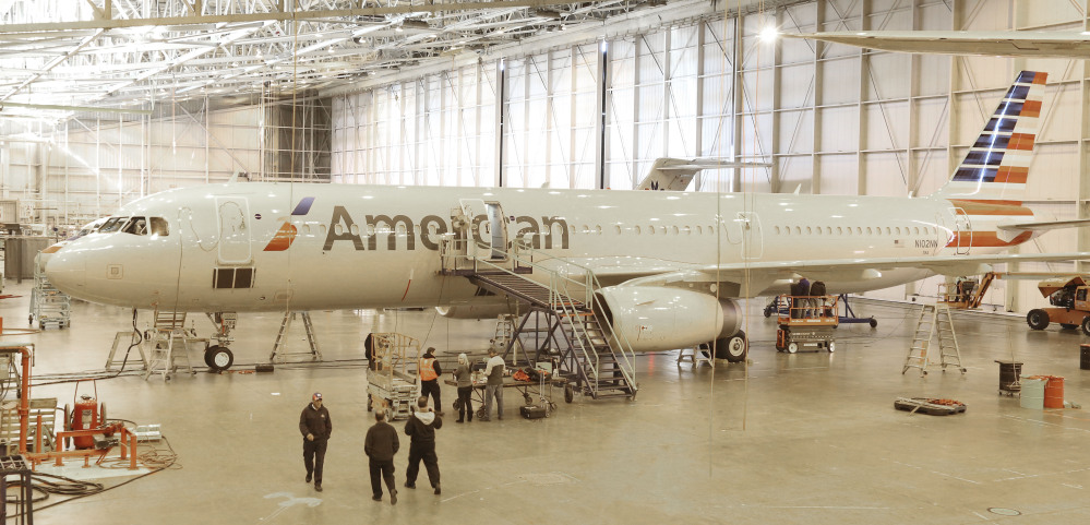 """A new plane is prepared for use at the American Airlines operations center hangar in Grapevine, Texas. American designed the interior of its new planes with the concept that """"your life should never be interrupted because you are flying,"""" says Alice Liu, managing director for onboard products for the airline."""