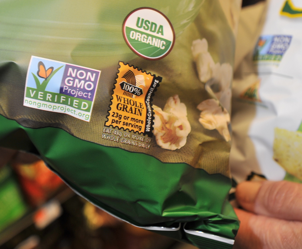 A label on a snack item at a Portland supermarket indicates it is certified organic and does not contain any genetically modified ingredients.
