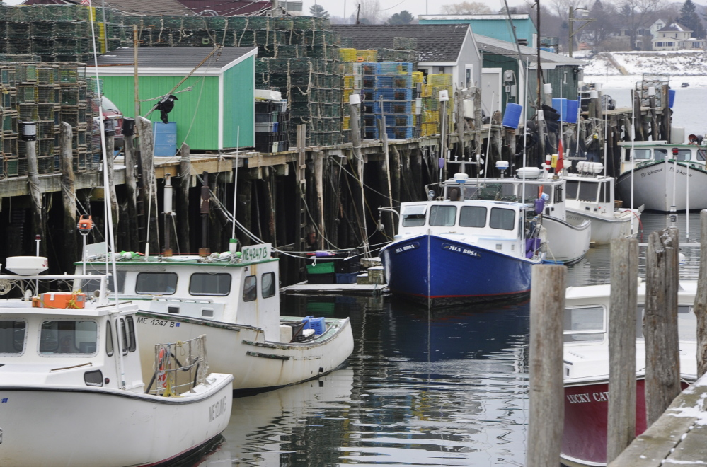 Lobster boats and traps along Widgery Wharf in Portland on Friday.