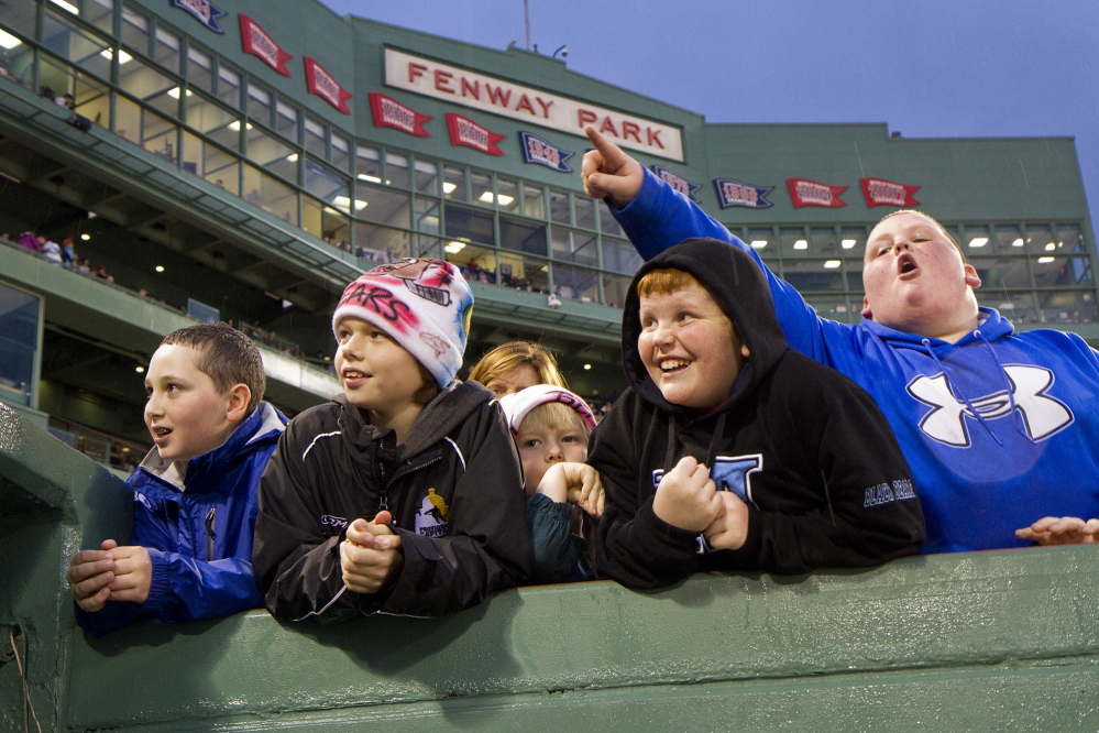 Fans of all ages who gathered at Fenway Park on Saturday for the game between UMaine and Boston University did not let the weather dampen their enthusiasm.