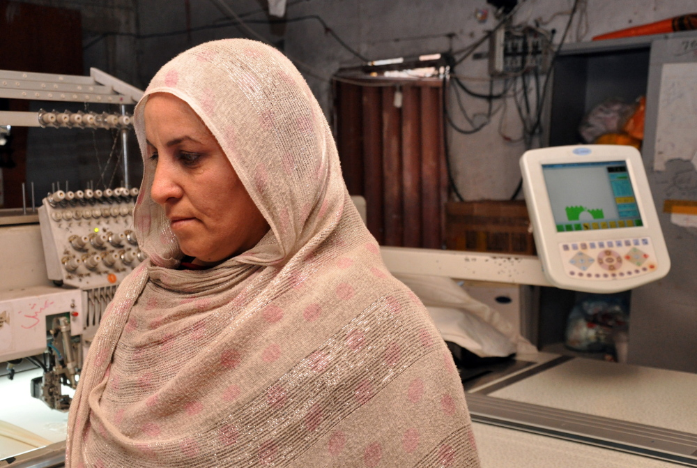 """Zarghuna Sherzad co-owns the Jahan Guldozi embroidery factory in Kabul, Afghanistan. """"I grew up in the war, and I've spent a very difficult time in the past,"""" she said of the Taliban rule. """"I'm always praying that regime should not be repeated."""""""