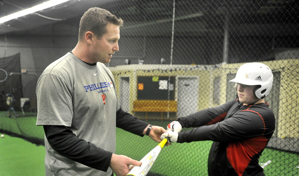 Nick Caiazzo talks about bat control with Cormic Lambert, 15, of Poland at the Edge Academy.