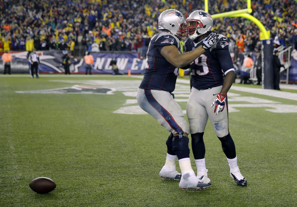 New England Patriots running back LeGarrette Blount, right, celebrates his touchdown with linebacker Jerod Mayo during the second half of an AFC divisional NFL playoff football game against the Indianapolis Colts in Foxborough, Mass., Saturday.