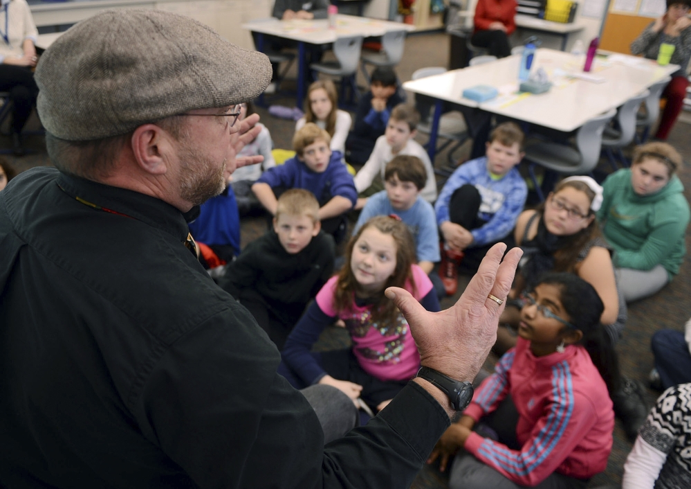 """Kevin McMahon discusses his anti-bullying book, """"Manny McMoose and His Chubby Caboose,"""" with fifth-graders in Jodi Ford's class at Great Neck School in Waterford, Conn. McMahon a semi-retired school psychologist from Groton, Conn., said he was bullied as a kid because of his weight."""