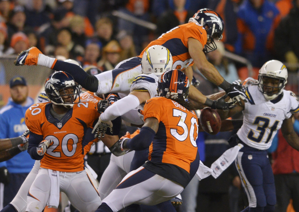 Denver Broncos wide receiver Eric Decker (87) leaps for an onside kick by thte San Diego Chargers in the fourth quarter of an NFL AFC division playoff football game, Sunday, in Denver. San Diego recovered the kick on the play.