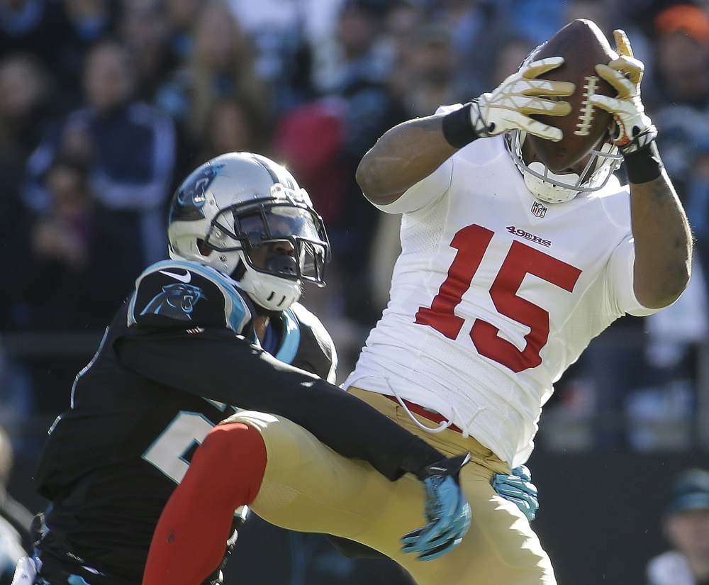 49ers wide receiver Michael Crabtree makes a catch against Panthers cornerback Melvin White in Sunday's NFC playoff game at Charlotte, N.C.