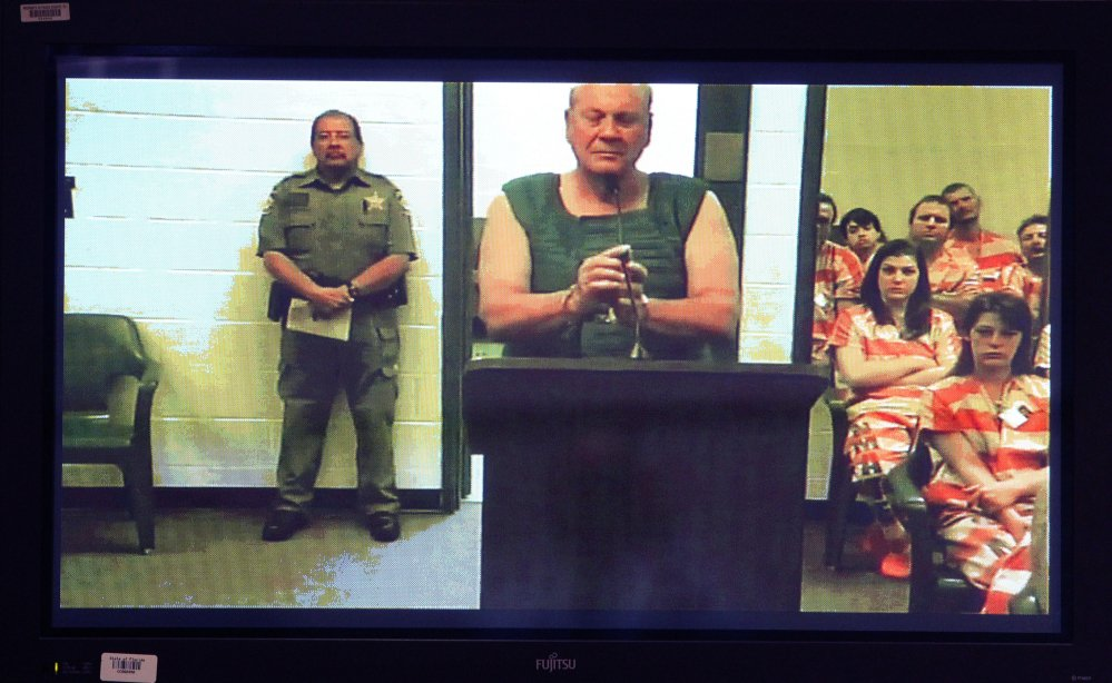 Curtis Reeves appears via video conference before Circuit Judge Lynn Tepper in Wesley Chapel, Fla. on Tuesday. Tepper ordered Reeves, 71, held without bond on a charge of second-degree murder in the death of 43-year-old Chad Oulson on Monday.
