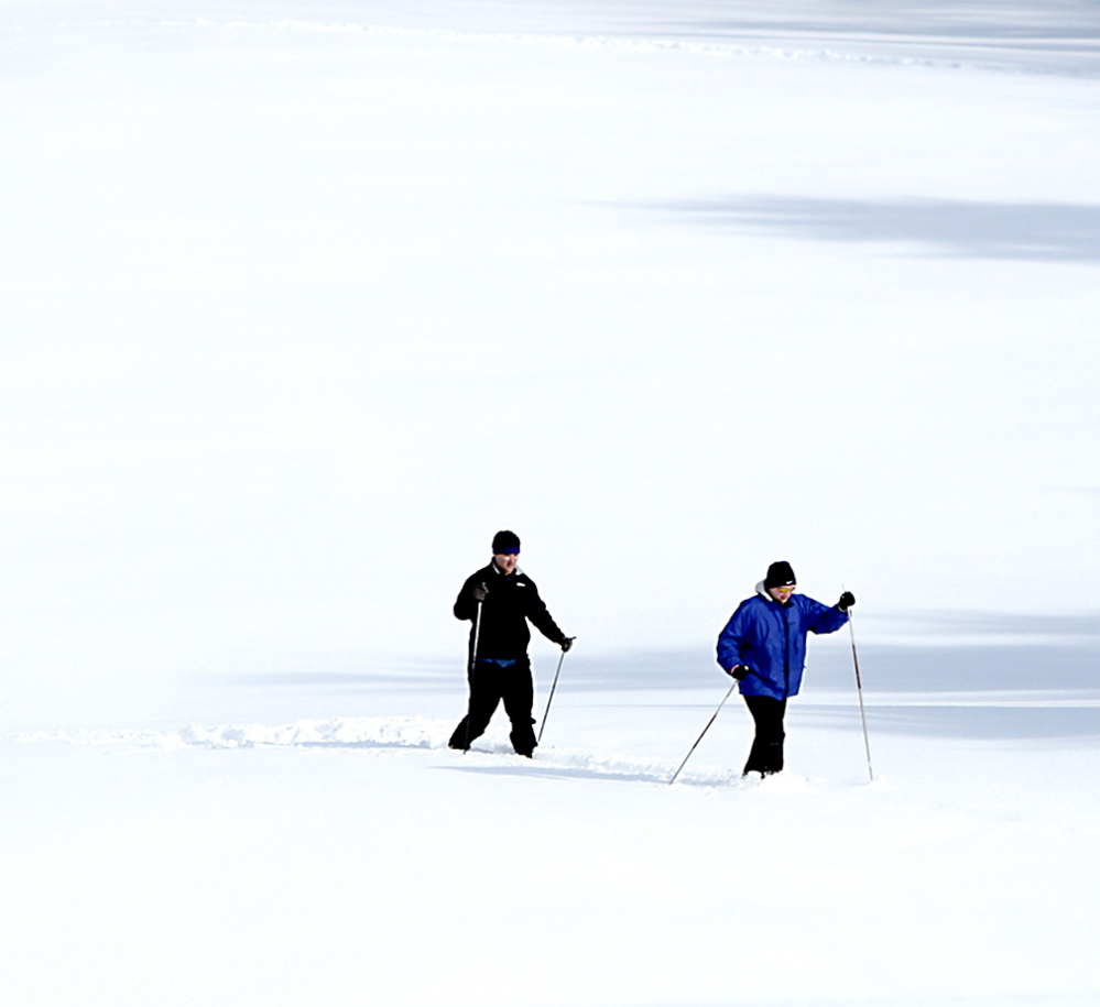 Jamie Nonni, left, and Will Rowan, both from Portland, break a new trail while cross-country skiing at Willowdale Golf Club in Scarborough.