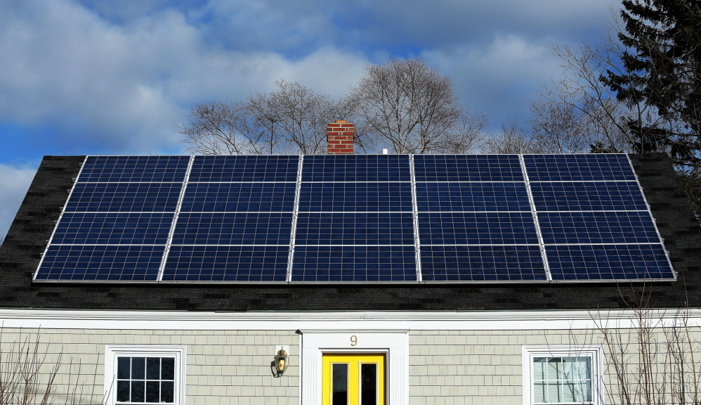 A solar panel array on the roof of a house on Lynda Road in Portland gathers sunlight Wednesday. Maine has only three to four megawatts of installed capacity at a time when solar power is taking off around the Northeast.