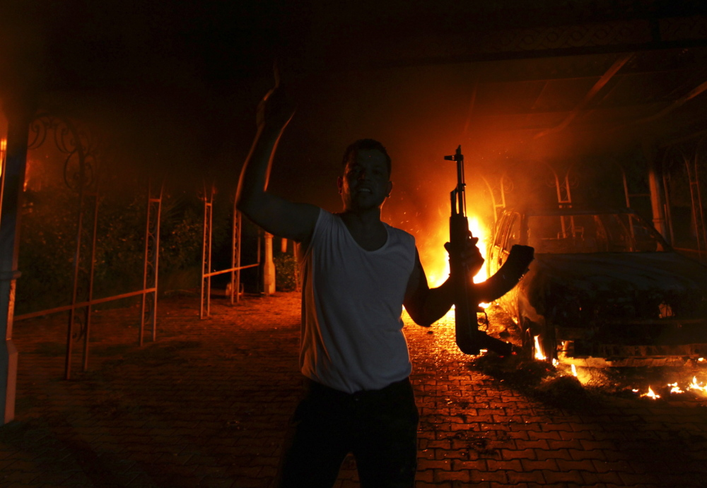 The U.S. Consulate in Benghazi, Libya, burns on Sept. 11, 2012. A long-delayed Senate Intelligence Report reveals that communications gaps contributed to inadequate security.