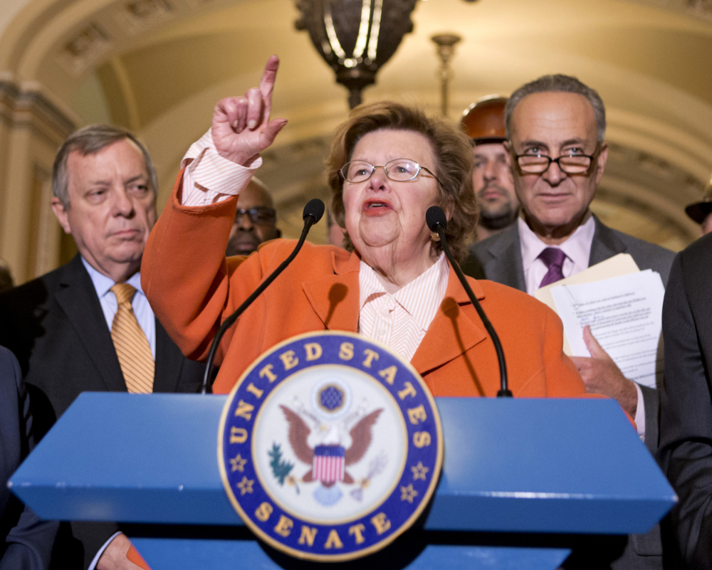 """Senate Appropriations Committee Chairman Sen. Barbara Mikulski, D-Md., flanked by Senate Majority Whip Richard Durbin of Ill., left, and Sen. Charles Schumer, D-N.Y., was a chief author of the spending bill. """"We met compelling human needs. We certainly preserved national security,"""" she said."""